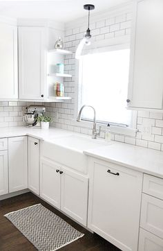Kitchen remodel. Pretty much all the things I want...subway tile, marble counters, white cabinets.