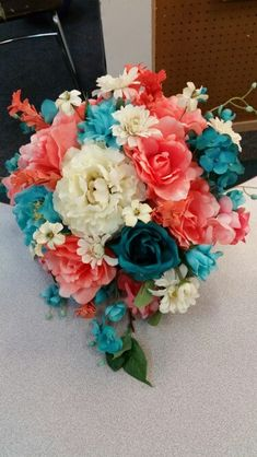 Teal & Coral country wedding bouquet.