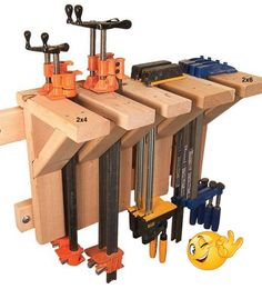 Another way to store those clamps that are laying around. Should work great with the French cleat slat wall! ...ortant step must be to set your financial budget. This may sound incredibly obvious but it is almost always the biggest mistake individuals make...use space that is used as a workshop and a place to park the family vehicles. The woodworker's tools must be portable so that they can be rolled out #anikasdiylife.com/20-simple-and-amazing-2x4-wood-projects/ #woodworking-shop-garage #woodwo Woodworking For Kids, Woodworking Store, Woodworking Workshop, Easy Woodworking Projects, Woodworking Plans, Wood Projects, Woodworking Classes, Woodworking Organization, Woodworking Furniture