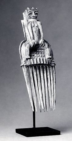Comb with Female Figure 19th–20th century Geography: Côte d'Ivoire Culture: Lagoon or Akan peoples, Akye group Medium: Ivory Dimensions: H x W: 1 3/4 x 5 1/2in. (4.5 x 14cm) Classification: Bone/Ivory-Implements