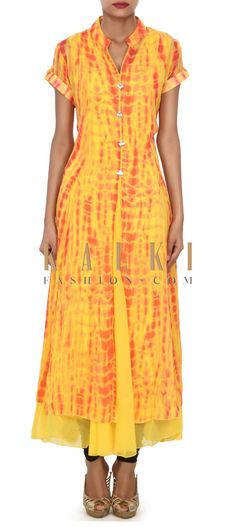 Buy this Yellow long dress adorn in fancy stone buttons only on Kalki