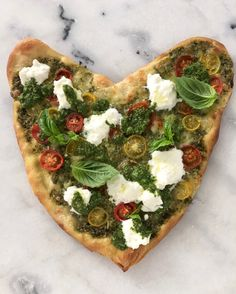 A super easy pesto sauce brushed over the best pizza crust: thin and crispy Valentine's day heart shaped pizza | CiaoFlorentina.com