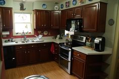 Here's a photo of the Mcallister kitchen remodel. Gorgeous cabinets, flooring & stainless steel undermount sink.