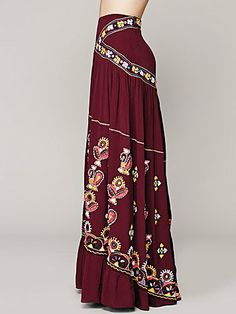 Free People maxi, featuring an elaborately embroidered ethnic design embellished with mirrors. Ruffled hem with slit in the center. Diamond Meadows Maxi