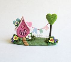 This miniature Fairy whimsy house of love with clothesline is a one of a kind original design and creation by artist C. Rohal. It is completely