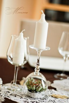 wine glasses as candle holders with plant inside