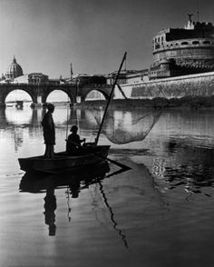 Herbert List 1949 Rome. Fishermen on the Tiber river in front of the Ponte San Angelo. In the rear is the Angelo, originally Emperor Hadrian's tomb, later a fortified retreat for threatened Popes. On the left is the St Peter's Basilica in the Vatican