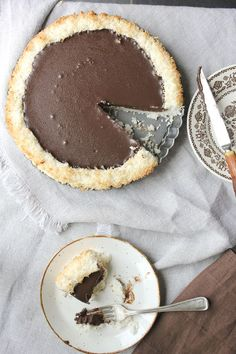 chocolate coconut pie with only 4 ingredients!  (chocolate, coconut, butter and cream...sounds like a winner to me.)