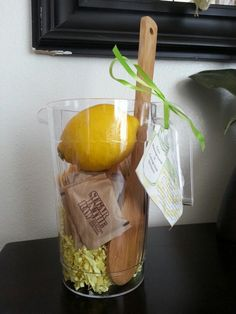 Great summer gift idea! A fresh lemonade kit. Lemons, sugar, and a spoon given in a pitcher with a lemonade recipe. Cute!
