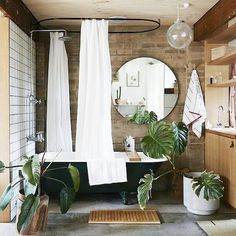 Once you see one, you keep seeing more! We love the features in this rustic-modern style bathroom find as well. Via Anthropologie #bathroomgoals #HHinteriorsinspo