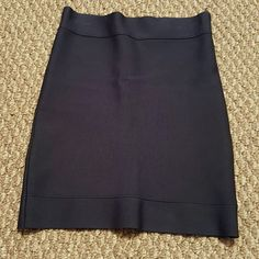 """BCBG """"Joelle"""" Navy Blue Bodycon  Mini Skirt A nice mini skirt with lots of life to give. Worn a few times. In great condition.  Strong Navy Bule color, fit to the body like a glove. Some hang inprint on top (shown in picture) BCBGMaxAzria Skirts Mini"""
