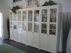 around fireplace in lounge? 4 IKEA liatorp bookshelves with doors
