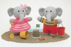 Cute elephants at the beach.
