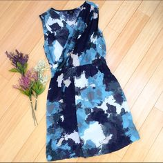 Watercolor blue summer dress, S. Fun faux wrap front dress by Mossimo. Rayon, machine washable. Bust is about 20 inches and very accommodating because of the wrap. Dress length is about 35 to 36 inches. This would look fantastic under a jacket, a sweater, or by itself. Dresses Midi