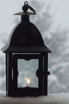 I love to watch the falling snow!  Click on the picture to see candle flicker and the snow fall.