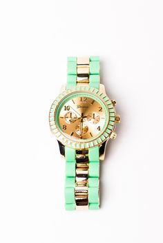 Gold and mint watch