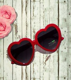 cute lolita red plastic thick heart shaped sunglasses with polka dots on the side in a vintage retro 50s pin up style with free shipping to the usa. Very cute and goes with any look from high fashion to cute and preppy to vintage and pin-up to lolita and kawaii