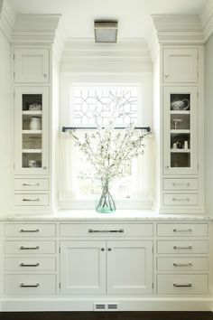 Heidi Piron Design and Cabinetry: Gorgeous kitchen with leaded glass window covered in cafe curtains. White built-in ...