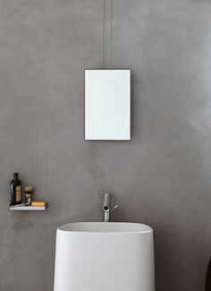 Agape, Minuetto #agapedesign - Suspended mirror with back in glacer white CORIAN® long cables and pivots in stainless steel + Pear C washbasin http://www.agapedesign.it/en/products/452-pear-c. Learn more on agapedesign.it
