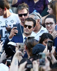 While amongst so many adoring fans, the cool and sunglassed Jamie Dornan took a moment to take a selfie.