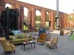 Lounge area featuring our sofas, chairs, tables and wine barrels - they were perfect in this beautiful outdoor historic setting, and provided great spots to sit during the cocktail party!  From the Richmond Weddings website re-launch party at Tredegar *Paisley & Jade...Vintage & Eclectic Furniture Rentals for Events, Weddings & Photo Shoots*