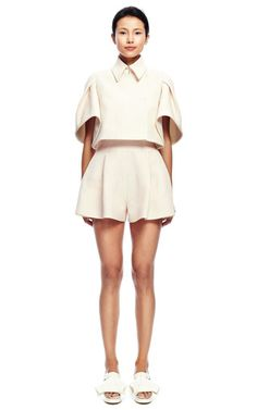 This cropped DELPOZO caplet features a voluminous short sleeve with pleating at the shoulder, a standard collar and an inverted pleat at the back.Hidden double-breasted snap button front closure.95% paper, 5% silkFully linedMade in SpainPlease note: This item is returnable for credit or full refund.