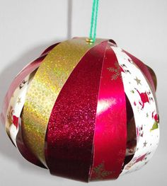 Wrapping paper bauble craft - showing 4 different sheets of Christmas wrapping paper