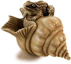 Antique Japanese Ivory Netsuke Toad Couching on Conch shell Signature: Tomomasa Circa: early 20th century H 2 in.(3cm), W 1.25 in.(3cm), D 1.25 in.(3cm)