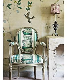 Dining room chair covered with Pierre Frey's Ming, which Nicky Haslam sprayed with tea to soften its whites.