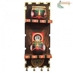This beautiful wall decor with hand painted terracotta face pots have been uniquely placed on a wooden frame to add color and life to your wall. The unique shapes of the pots have also been kept into consideration while placing them in the frame.
