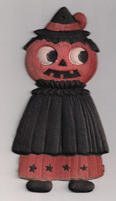 Made in Germany.   Halloween Diecut JOL Lady in a Cape from milkweedantiques on Ruby Lane.