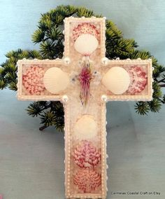 White and pink sea shell decor cross with by CarmelasCoastalCraft