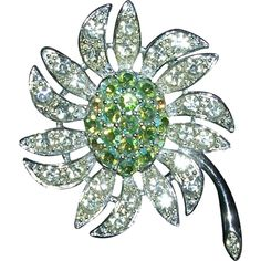 A fabulous design, this Sarah Coventry brooch pairs large, clear rhinestones with pale green, aurora borealis center stones to depict a beautiful daisy like flower. In excellent condition; Flower Brooch, Brooch Pin, Sea Glass Jewelry, Fine Jewelry, Jewelry Box, Flower Jewelry, Antique Jewelry, Vintage Jewelry, Sarah Coventry Jewelry