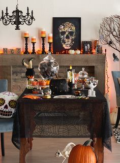 From a sprinkling of candy corn candles to a smattering of creepy plastic skulls, set the scene for a Halloween party that's both spooky and spectacular. Featured product includes: Celebrate Halloween Together spiderweb tablecloth, skull pillow, masked cat throw pillow candy corn candles, shimmer flameless candle and plastic skulls, and Americanflat vintage skull framed wall art. Get set for Halloween at Kohl's.