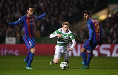 Stuart Armstrong of Celtic (C) is fouled by Sergio Busquets of Barcelona (L) during the UEFA Champions League Group C match between Celtic FC and FC Barcelona at Celtic Park Stadium on November 23, 2016 in Glasgow, Scotland.