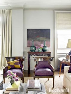 """Designer Alexander Doherty updated a 1911 apartment in Manhattan with """"a color story."""" A pair of 1920s Regency-style armchairs add graceful curves to the living room."""