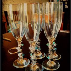 Decorated champagne glasses for the wedding :)