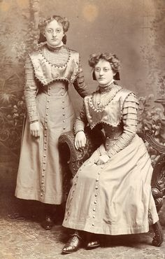 Found image. These girls wear rather beautiful matching dresses.
