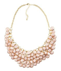 Light pink statement necklace.