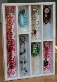 Jewelry holder made from cutlery organizer, old door knobs, and scrapbook paper.