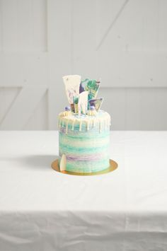 Under the Sea themed buttercream cake with chocolate drip and shards by LionHeart