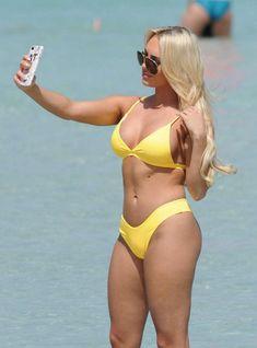 d57fdc6271b04 Amber Turner in a Yellow Bikini on the Beach in Dubai – March 2018