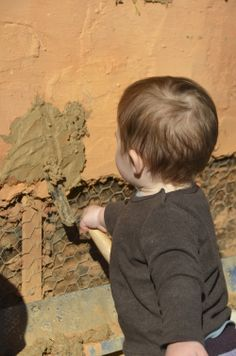 18 months is a bit young, but I thought he did great job! (Although he always puts his plaster on the wrong side of his trowel..)