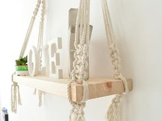 Hanging macrame shelf are so all around and very decorative. The yarn creates lovely, geometric and modern shaped home decor. Can hang from wall or ceiling Made with cotton rope and recycled pine Board, cut and sanded by hand!!! 100% handmade   Board measures: height: ~~~~~~~~~~~~~~~~~~~ CUSTOM ORDERS: Want a smaller or larger size? Or a different style that represents you or a loved one? Just send me a convo. ~~~~~~~~~~~~~~~~~~~  Please contact me for any questions or suggestions.