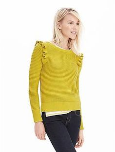 The ruffles on the shoulders help to widen the shoulder to balance wider hips.  Ruffle Pullover Sweater | Banana Republic