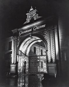 I don't have a date on this night shot of the Paramount Pictures gate, but it looked like this for years. What I love about the way they've lit it. The lighting really shows the texture of the columns, and decorative motifs over the arch. And look at how the light at the back projects the intricate ironwork of the gates onto the walls of the arch. Really, is it any wonder this gate has become such an icon of the Hollywood film industry?