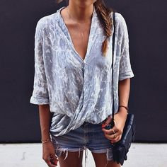 Casual denim look, cut off shorts, wrap over blouse, street style