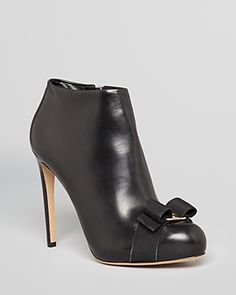 {salvatore ferragamo royal vara high heel platform bow booties in black - fall 2013}