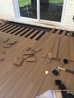 Here's an easy way to lay deck flooring on your cement slab patio in just one day. It dresses up an otherwise drab patio, and it's so nice for bare feet!