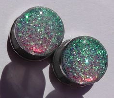 Alice In Iridescent Land Sparkle Fake Plugs Embedded by GlitzGauge, $15.00  These are great if you dont want stretched ears, but awesome earrings that you cant find in a store. They look like plain studs!